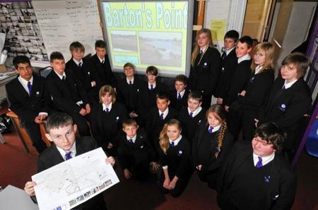 Some of the pupils involved, with a map of the coastal park