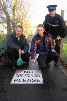 Swale council dog warden Tim Oxley, Environment Warden Daniel Bacon and PCSO Robert Holmes with the No Dog Fouling Please message in Labworth Alley, Halfway