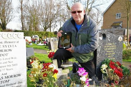 Christopher Gibbs at the grave of his parents Tony and Audrey at Sheerness Cemetery