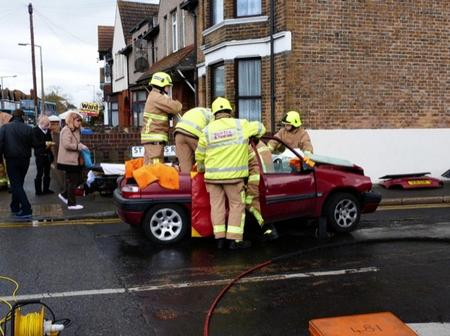 Firemen work to free a woman in St Helen's Road, Sheerness, following an accident