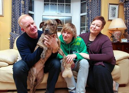 Jim and Veronica McKnight and their 17-year-old son James with Fenton, now renamed Munro, who was Battersea Dogs' Home's longest resident after spending a record 401 days there