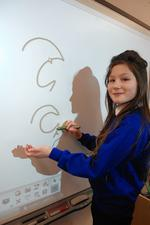 Millie Thompson-Dwyer,10, writes her name in shorthand during a lesson about journalism
