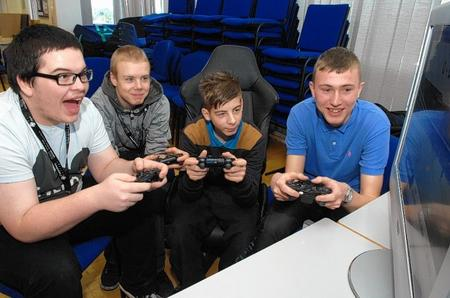 Terry Wells, Jack Bonner, Ben Simmonds and Shaun Clark play one of the electronic football games