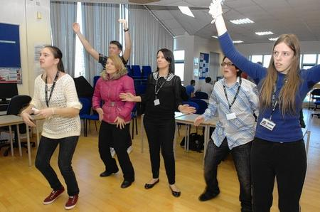 Students dance using a Wii