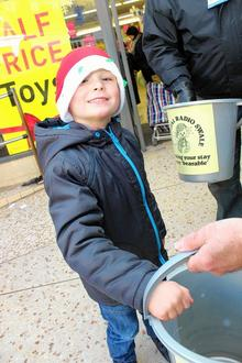 Oliver Stephenson, aged 4, from Sheerness, makes a donation