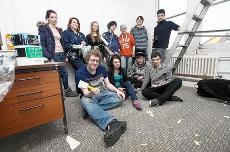 Members of the Restoration Youth group renovate the office so it can be used by them