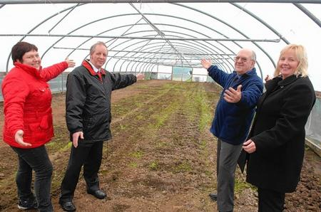 Community gardener Nicola Waghorne, Nigel Martin and Mike Brown of Sheppey Matters, with Dawn Mauldon, head of rehabilitation at Sheppey Prisons, in one of the polytunnels given over for use as allotments near Eastchurch Prison