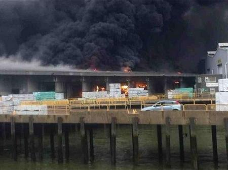 Flames are seen at the site of the Sheerness warehouse blaze.