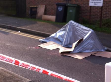 Police tent at scene of shooting in Dartford where Kevin Mckinley was killed.