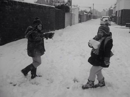 Siblings Max and Grace Kelly enjoy a snowball fight in Deal