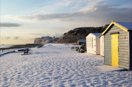 Colourful beach huts contrast the snow at Kingsdown, near Deal. Picture: Gemma Green