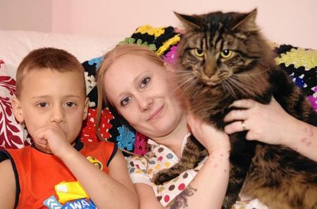 Amy McNeill with her son Jake, 5, and her cat Tinkerbell. Tinkerbel went missing 18 months ago, and ended up in Warwickshire.