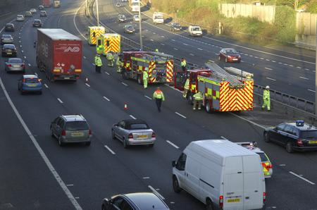 Fire crews cut two people from a crashed car on the M20. Picture: Martin Apps