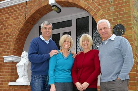 From left, Chas and Diane Howell, Jo and Graham Hatfield. Twins Jo Hatfield and Diane Howell have lived together in the same house with their respective husbands and children since 1989.