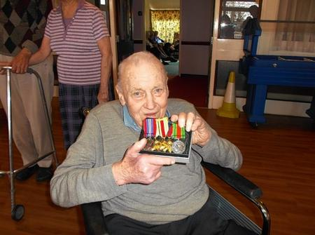 Frederick Beaves, 92, a Court Regis resident is reunited with his war medals