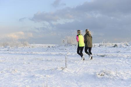Joggers brave the snow on Walmer seafront. Picture: Tony Flashman