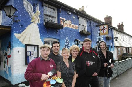 Pub staff and mural artists outside the Hawkenbury