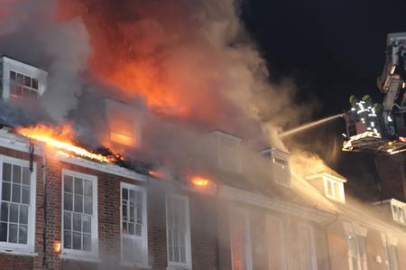 Fire crews battle a blaze in West Malling High Street on January 11, 2013. Picture: Jeffrey Hurst
