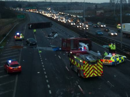 The aftermath of the crash on the A2 in which a transporter overturned.