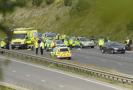 Emergency services at the scene of the crash on the A249. Picture: Barry Crayford