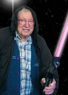 Alf Nicholls, a resident of Abbeyfield Kent Society, with his Star Wars lightsaber