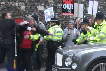 Scene of chaos as police surround protester ahead of the Archbishop of Canterbury's enthronement.