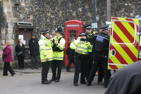 Police at the scene of an arrest at the enthronement of the Archbishop of Canterbury today.