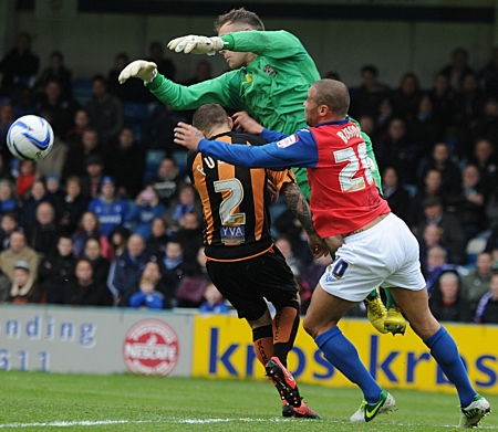 Deon Burton is denied by a combination of Barnet keeper Graham Stack and former Gillingham captain Barry Fuller