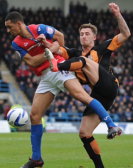 Lewis Montrose in a struggle to break clear from his man