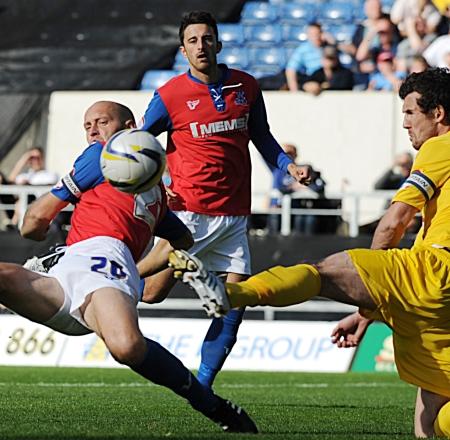 Gills skipper Adam Barrett gets stuck in