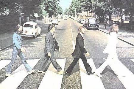 The Beatles with their original Abbey Road album cover