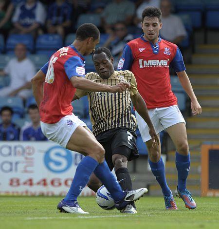 Kyel Reid takes on Lewis Montrose