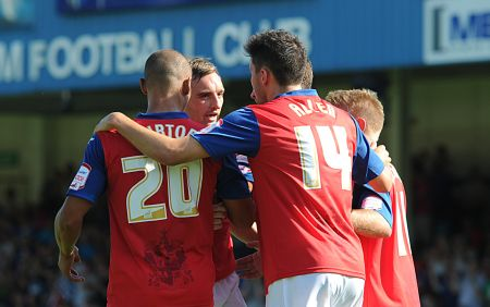 Gillingham celebrate their second goal on Saturday