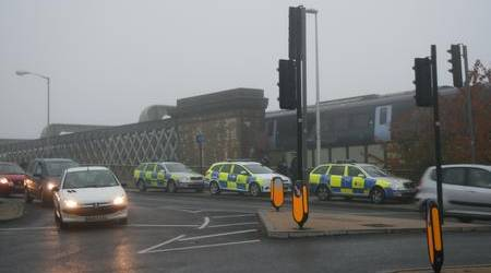Police at Rochester railway bridge after a man threatened to jump