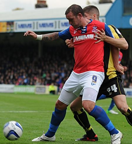 Danny Kedwell holds off Rob Kiernan