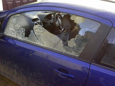 The smashed passenger window on Troy Wareing's Corsa