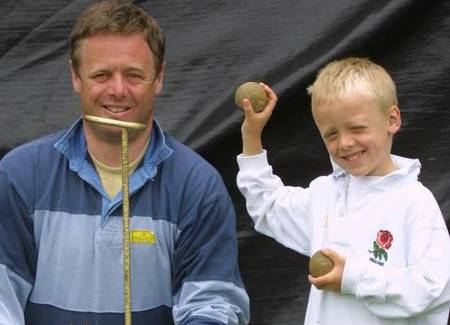 Charlie Booth aged five with his father Nicholas enjoying the coconut shy at the Museum of Kent Life in June 2002