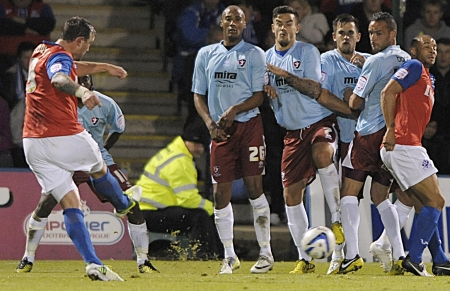 Danny Kedwell takes aim from this free-kick