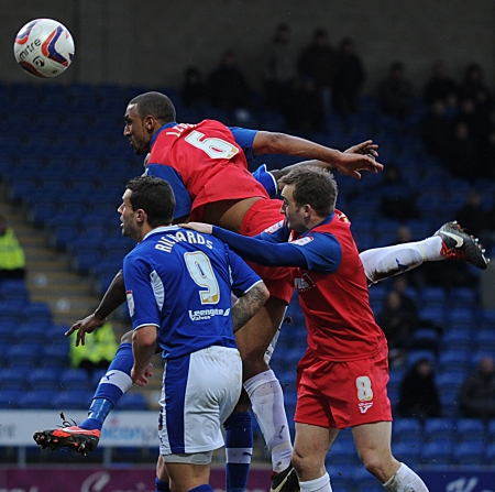 Leon Legge rises highest to win this aerial ball as Gills keep another clean sheet on the road and re-write club history
