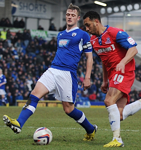 Anton Robinson is forced wide by Chesterfield skipper Liam Cooper