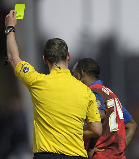 ...but Weston is shown a yellow card for his trouble