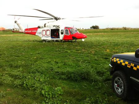Coastguard Rescue 104 helicopter from Lee-on-the-Solent landing near Lower Stoke
