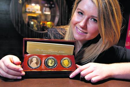 Christine Buss, from Scoin Shop, displays some of the Diamond Jubilee coins. Picture: Ally Carmichael
