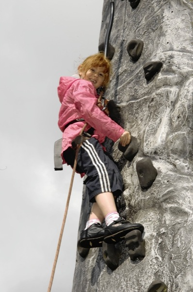 Lexie Foord, seven, climbing on the climbing wall.