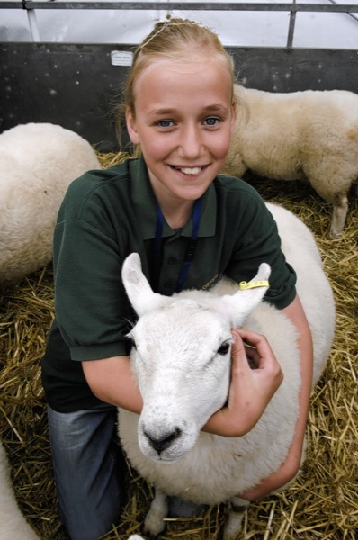 Lilly Essex, 13, with Rolo the sheep. Lilly is part of the Cobtree Young Farmers, who are based at Kent Life.