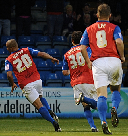 Deon Burton wheels away in delight after doubling the Gillingham lead in the 65th minute