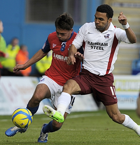 Former Gills favourite Andy Barcham takes on Bradley Dack in what was a disappointing Priestfield return for the winger