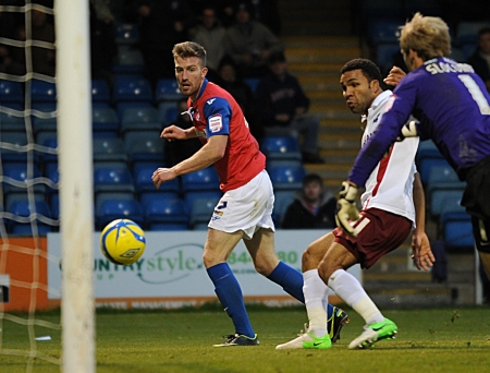 Matt Fish beats Sam Slocombe to open the scoring for Gillingham against Scunthorpe