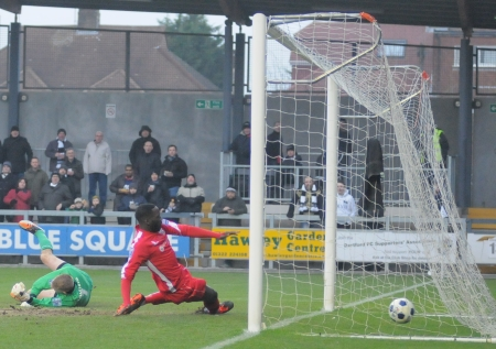 The Bromley defence try in vain to stop new Darts signing Dominic Green from scoring
