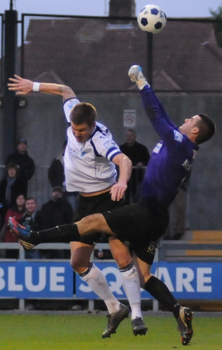 Elliot Bradbrook and Southport keeper Tony McMillan in aerial combat